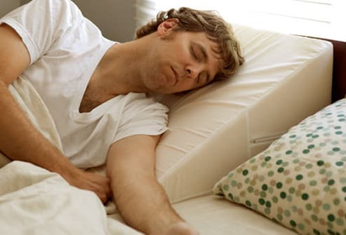 Man Using Wedge Pillow to Help with Heartburn