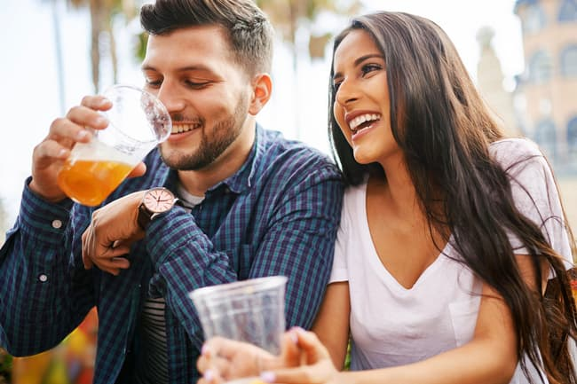 photo of couple drinking beer in cafe