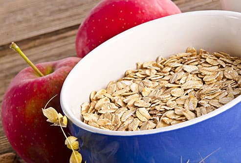 apples with bowl of oats