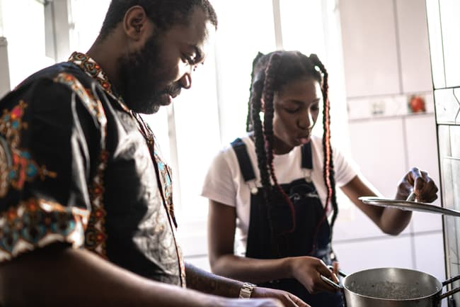 photo of father and daughter cooking