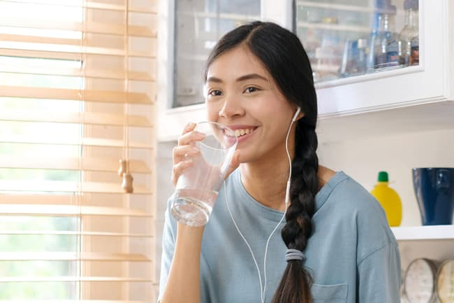 photo of teen drinking water