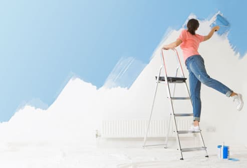 Woman Balancing On Ladder