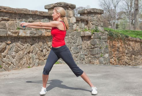 Woman Doing Side Lunge With Reach