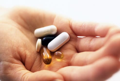 Handful Of Vitamin Supplements