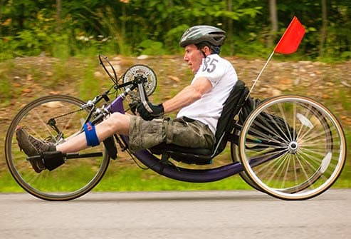 man riding recumbent bike