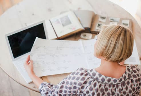 Woman Looking At Genealogical Tree