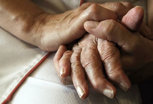 comforting hands alzheimers patient