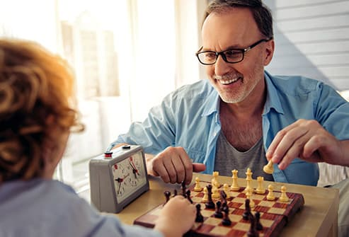 mature man playing chess