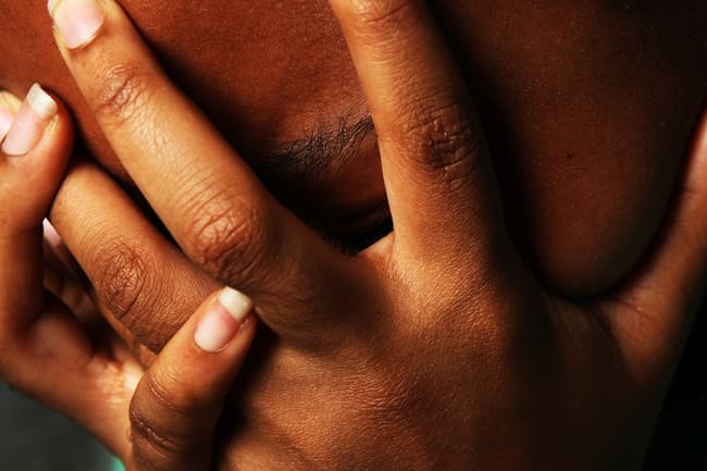 photo of hands over face