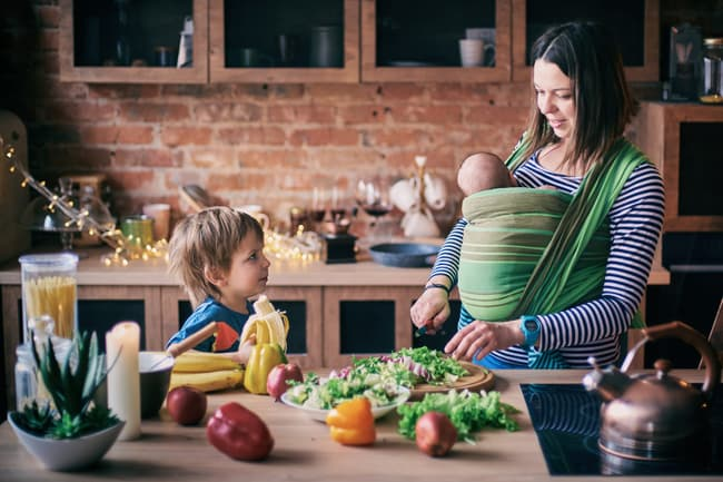 photo of mother making salad