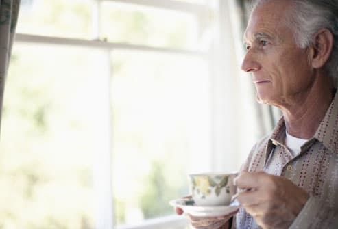 Older man drinking coffee
