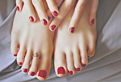 a3ac02355058 red nail polish on fingers and toes