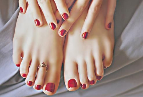 red nail polish on fingers and toes