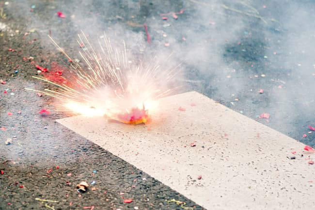 firecracker exploding on street