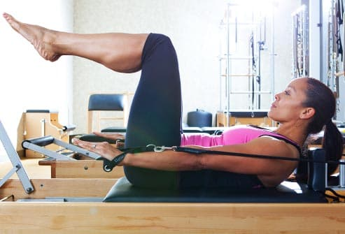 woman doing pilates hundred on reformer