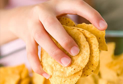 Handful of tortilla chips
