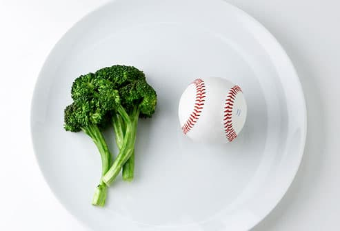 Broccoli and baseball on plate
