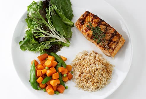 Healthy portions of fish, rice, and vegetables