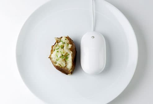Potato and computer mouse on plate