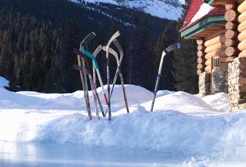 hockey sticks in snow
