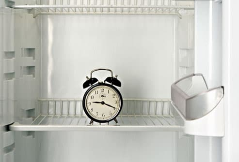 Interior of refrigerator and clock