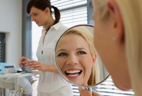 smiling woman at dentist office