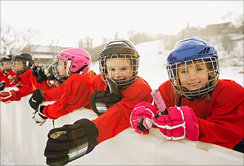 kids in hockey helmets