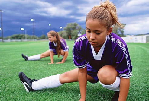 soccer players stretching