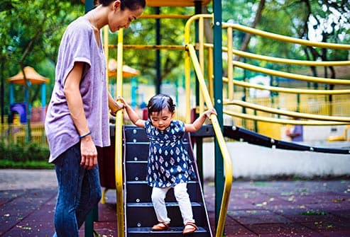 mom with daughter on playground