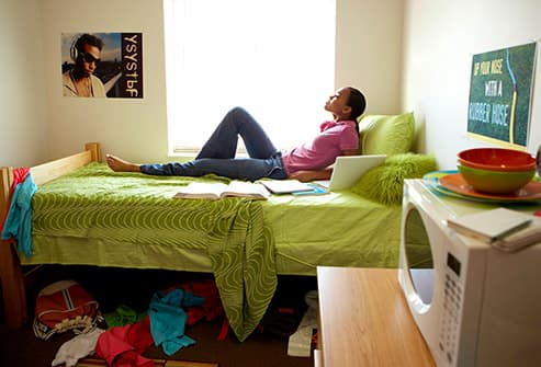 teen in dorm room