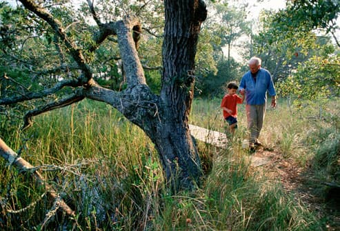 Grandfather and Grandson Taking A Walk