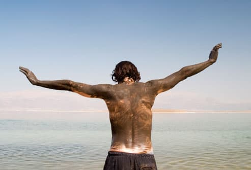 Man Treating Psoriasis with Climatotherapy