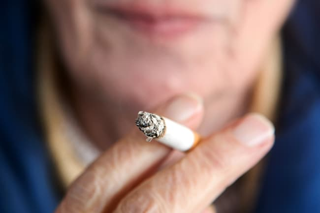 photo of mature woman smoking