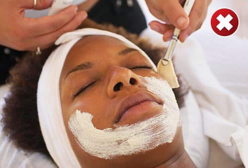 Woman on spa table having a facial