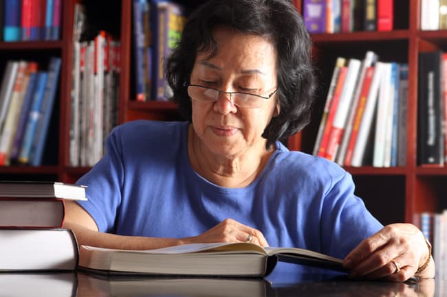 photo of senior woman in library