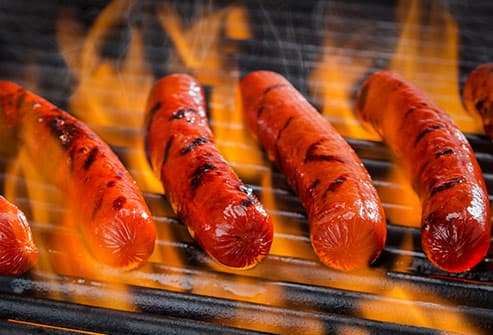 hot dogs on grill