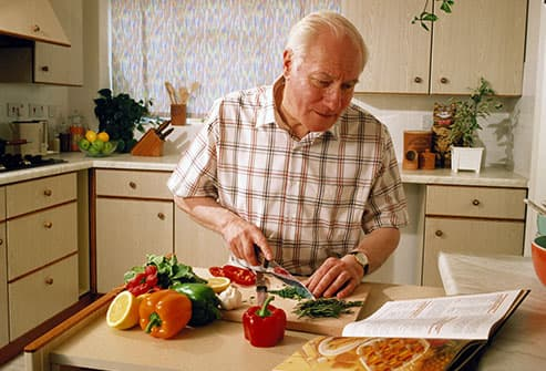 man using recipe book