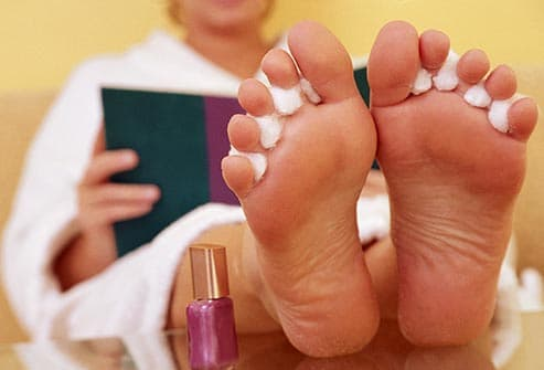 woman getting pedicure