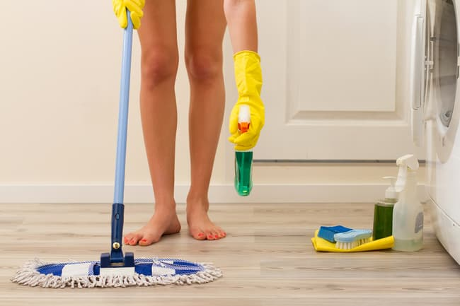 photo of woman mopping floor
