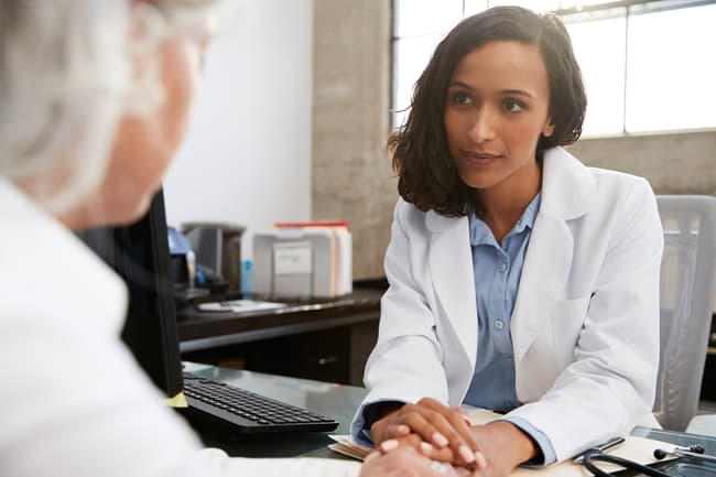 Photo of doctor listening to patient