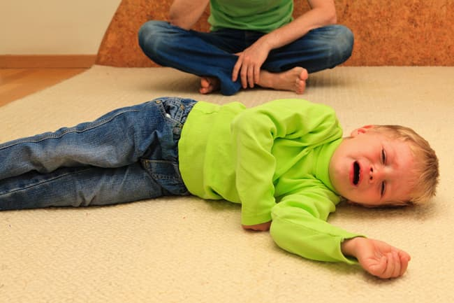 child crying on floor