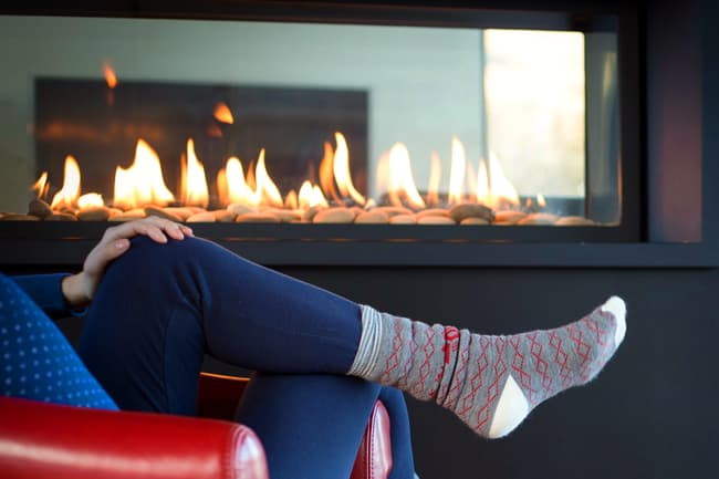 person sitting in front of fire place