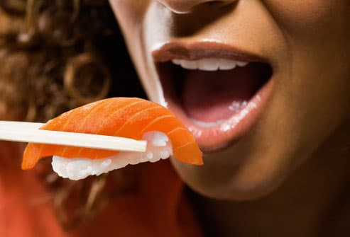 Woman Enjoying Salmon Sushi