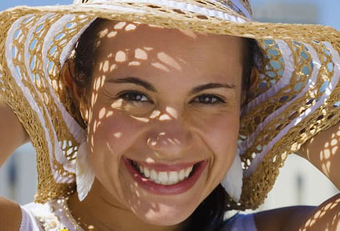 Woman Shielding Skin From Sun Damage