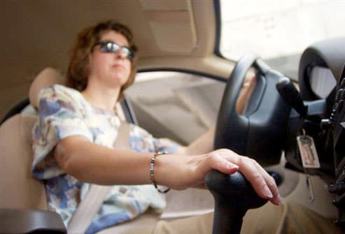 Woman with RA driving easy-to-shift car