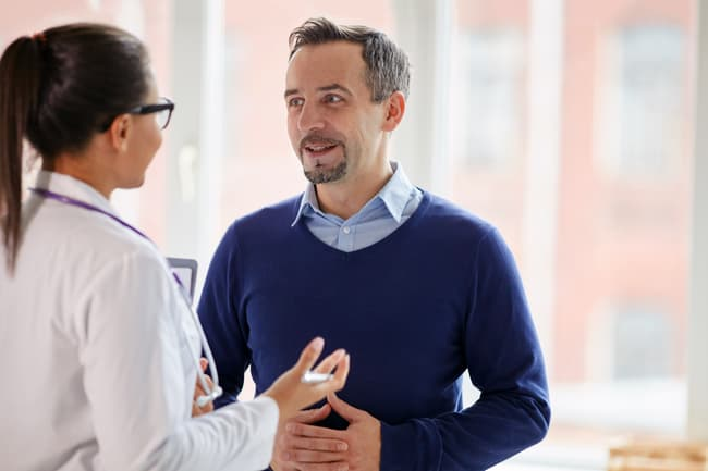 photo of patient talking with doctor