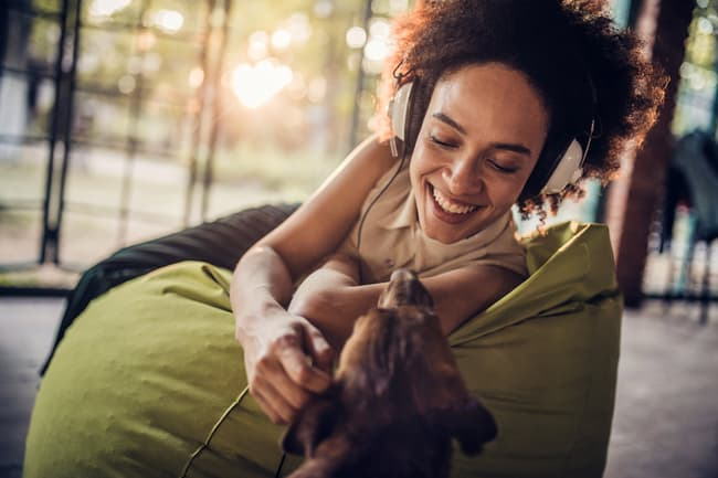 photo of woman playing with dog