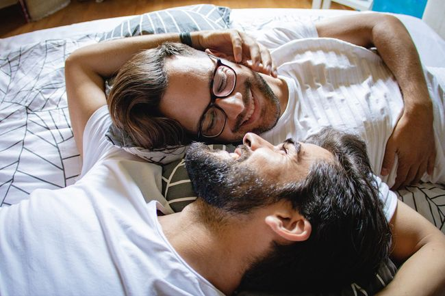 photo of romantic couple on bed