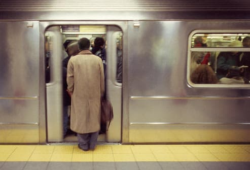 man getting on subway car