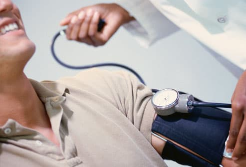 Doctor Checking Man's Blood Pressure
